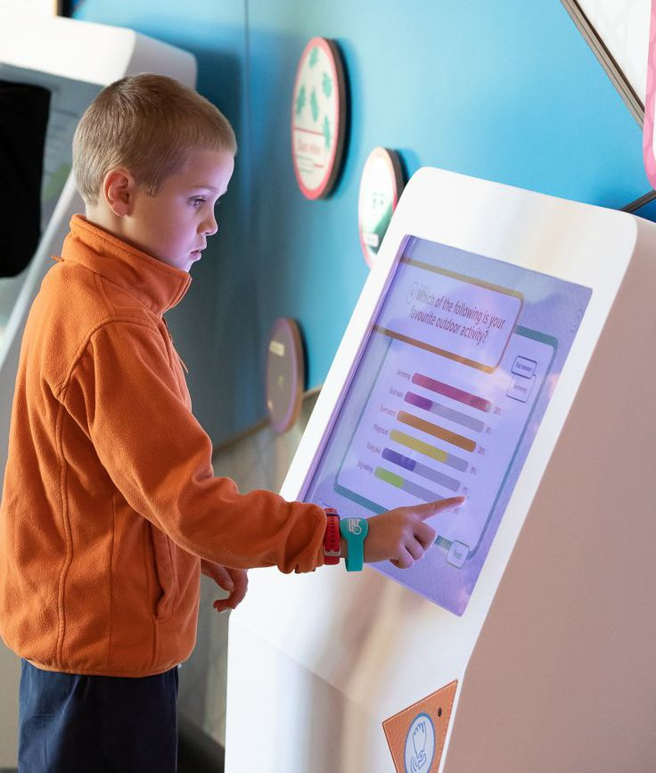 Testing out the interactive games at the Discovery Centre