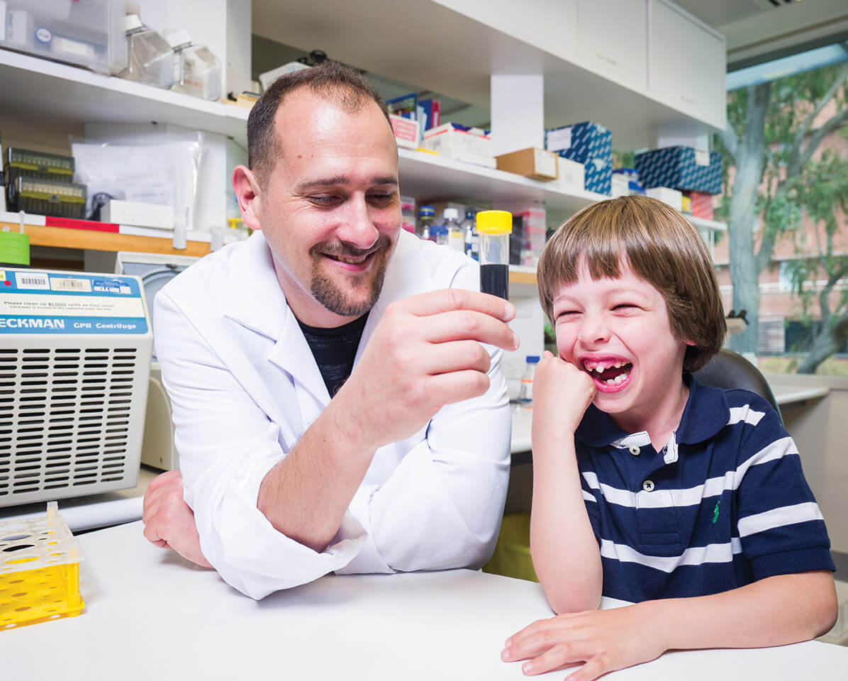 Dr Anthony Bosco and Samuel share a laugh in the lab